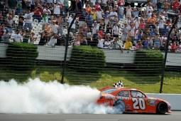 2012_Pocono_June_Sprint_Cup_Joey_Logano_Celebrates_With_A_Burnout