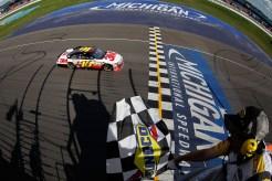2012_Michigan_Aug_NSCS_Greg_Biffle_crosses_finish_line