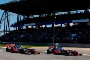 Jenson Button and Sergio Perez on track