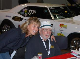 """Bill """"Grumpy"""" Jenkins gets a hug from a fan at the 2011 Muscle Car and Corvette Nats (www.mcacn.com) in Chicago. Grumpy died a few months later."""