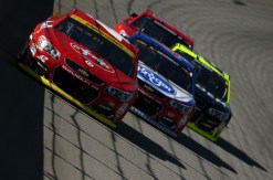 Kyle Larson leads a pack of cars. (Photo by Sean Gardner/Getty Images)