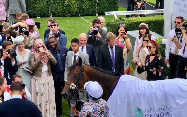 The winning team take the applause at Goodwood