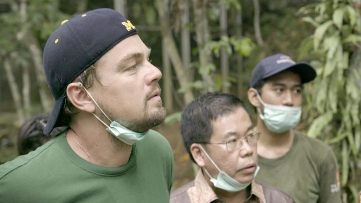 INDONESIA- Leonardo with Orangutans in the Leuser Ecosystem. For two years, Leonardo DiCaprio has criss-crossed the planet in his role as UN messenger of Peace on Climate Change. This film, executive produced by Brett Ratner and Martin Scorsese, follows that journey to find both the crisis points and the solutions to this existential threat to human species. © 2016 RatPac Documentary Films, LLC and Greenhour Corporation, Inc. All rights reserved.