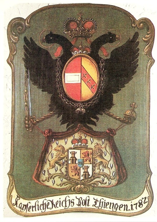 "A postboard ( Posttafel ) from 1782, of the type displayed outside Austrian post offices under the old régime. The arms above are a simplified version of the Austrian imperial arms of the time; the arms below are those of the princely family of Thurn und Taxis , who held an imperial license to operate the post office as a monopoly. The legend means Imperial Government Post Thiengen 1782 . The cover was issued by the West German Post Office in 1979 as part of the annual ""Europa"" series marking the meetings of the European Conference of Postal and Telecommunications Administrations ."