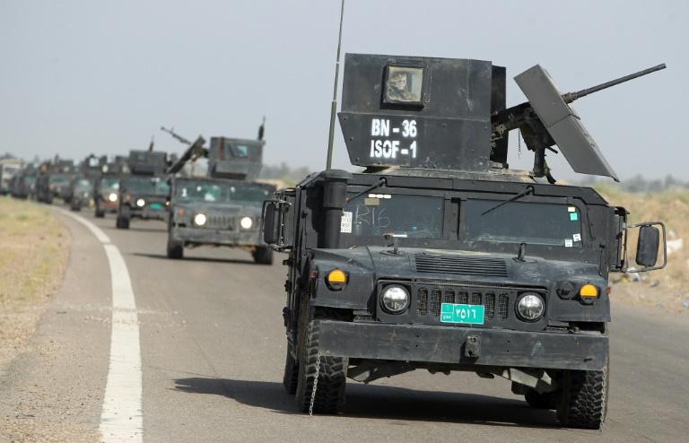 Les forces du contre-terrorisme irakiennes se dirigent le 28 mai 2016 vers al-Sejar près de Fallouja . © AFP