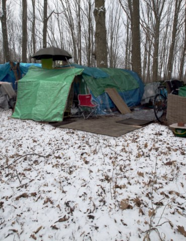 Homeless Camp, photo by Cory Doctorow, via flickr (CC BY-SA 2.0); background: snow covered landscape, Shutterstock.