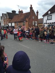 Jon pushes Ant down Pinner High Street in the wheelbarrow race