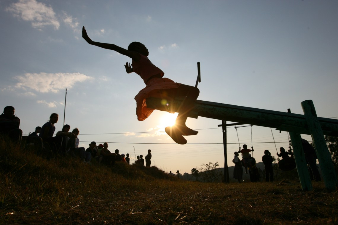 A young girl tests out a new seesaw on a playground built by the Elizabeth Glaser Pediatric AIDS Foundation at the Mkhulamini Clinic in Swaziland