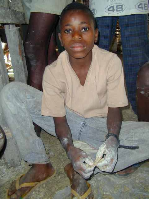 Boy learning pottery in a refugee camp in Guinea