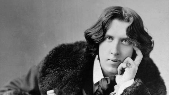 The writer Oscar Wilde, tried and imprisoned for his relationship with a young aristocrat, one of the more tragic and infamous chapters in the story of 19th + 20th-century homosexual men