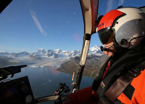 Chief pilot Peter Garden flying on South Georgia Island with Nordenskjold Glacier.