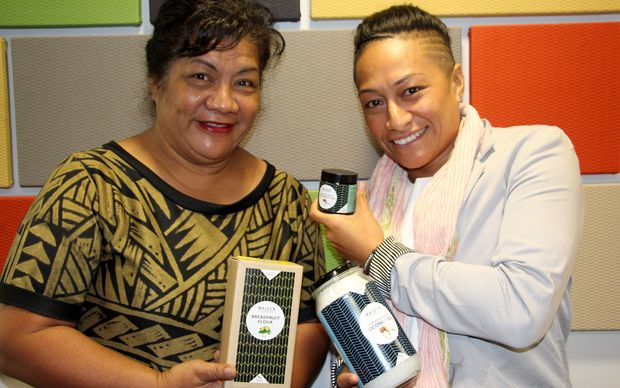 Two of the Directors of Maiden South Pacific, Kalala Mary Autagavaia (L) and Tiana Epati holding their organic coconut oil and breadfruit flour products.