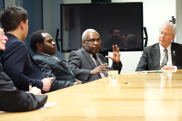The secretary-general of the United Liberation Movement for West Papua, Octo Mote (centre) talks to New Zealand MPs, including Steffan Browning (right).