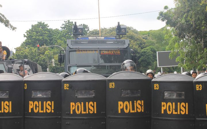 Indonesian police at a demonstration in the Papuan region.