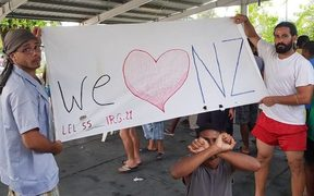 A banner from 104th day of protest on Manus Island