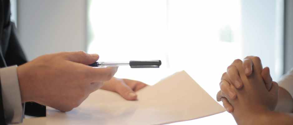 crop businessman giving contract to woman to sign