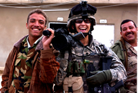 Linsay Rousseau Burnett (right), a sergeant in the U.S. Army, spent one year as an Army journalist in Iraq. Source:  Linsay Rousseau Burnett