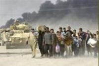 Iraqi refugees flee the burning city of Basra.  Source: Scotsman.com