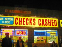 A check-cashing/pay day loan center. Photo credit: flickr.com/photos/pjchmiel/22532534