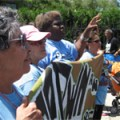 Women from the Peoples Freedom Caravan arrive marching into the USSF