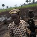 Women next to an oil wellhead that has been spilling crude oil near the community of Ikot Ada Udo, the Niger Delta, since 2004  © Kadir van Lohuizen/NOOR