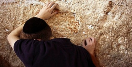 A Jewish worshipper prays at the Western Wall during prayers marking Tisha B'Av, in Jerusalem