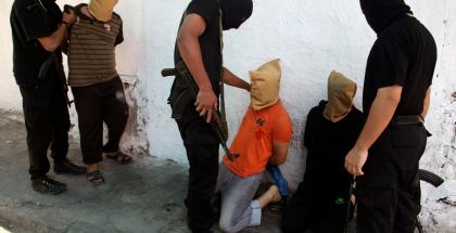 Hamas militants grab Palestinians suspected of collaborating with Israel in Gaza City