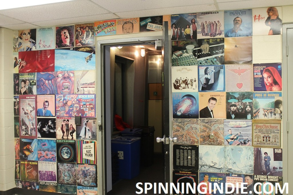 Album covers surrounding entrance to college radio station WLOY