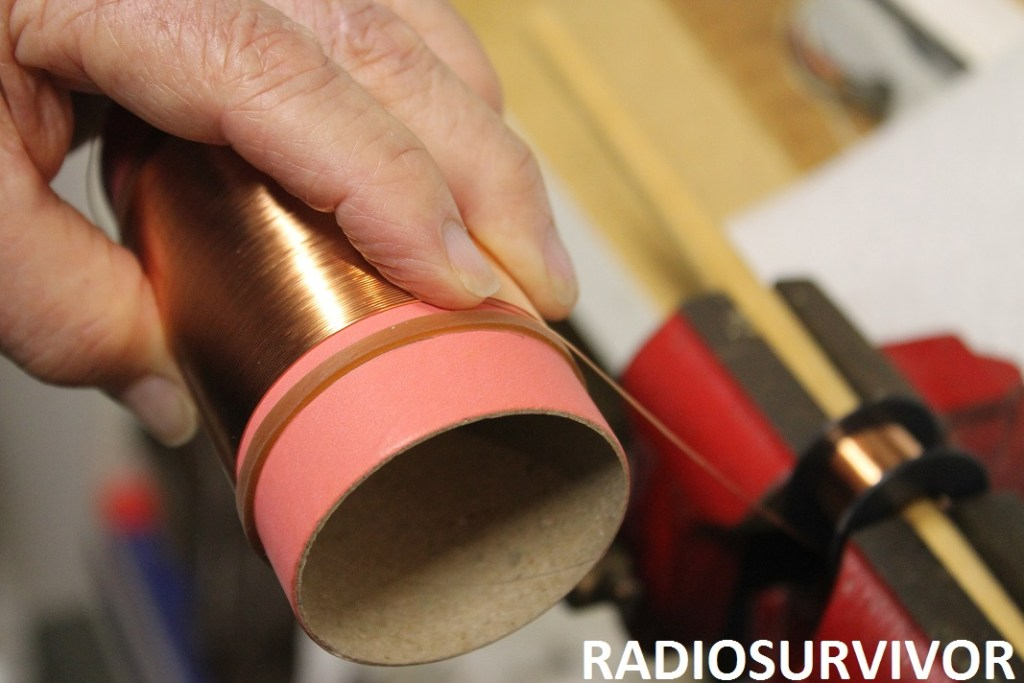 winding copper wire onto paper tube