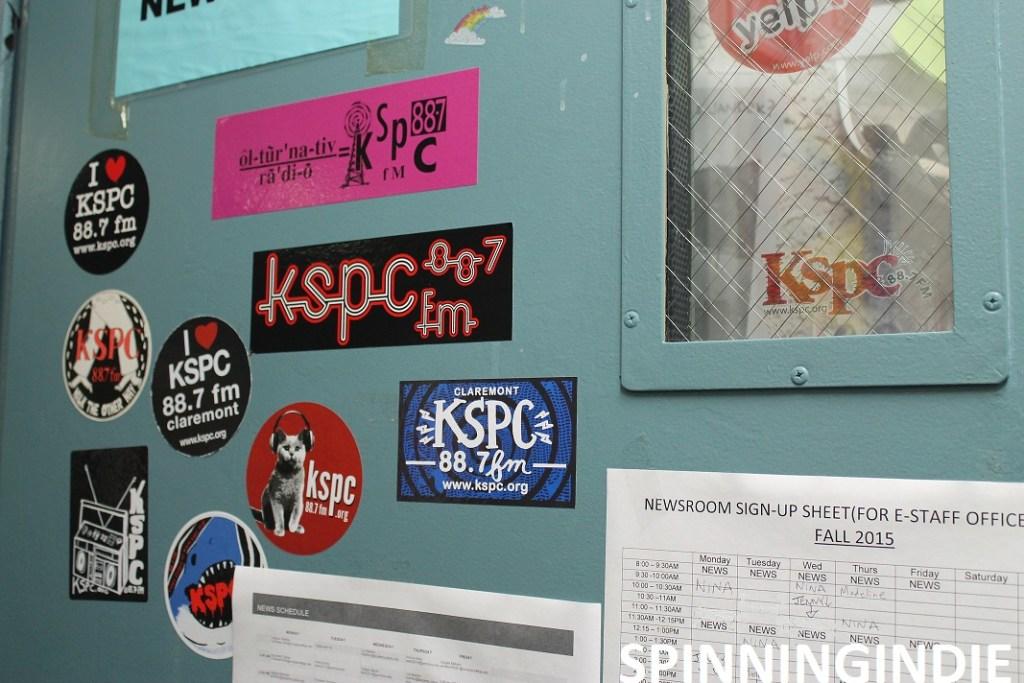 KSPC stickers on News Room door. Photo: J. Waits