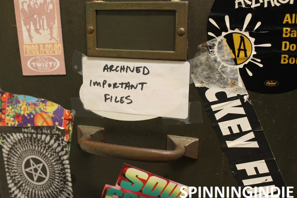 """""""Archived Important Files"""" post on cabinet at college radio station WMCN. Photo: J. Waits"""