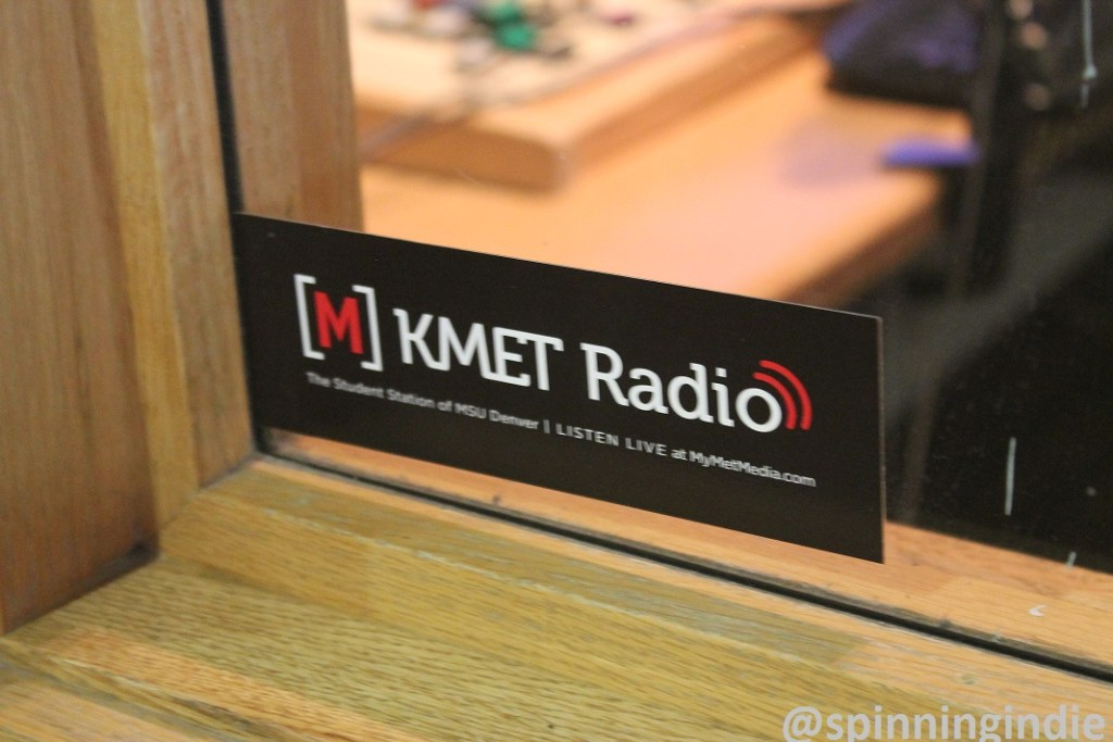 Met Radio sticker on window to college radio station booth. Photo: J. Waits