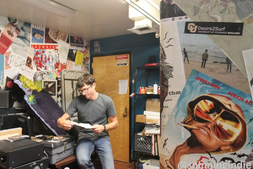 Mikey Goldenberg in music office at Radio 1190. Photo: J. Waits