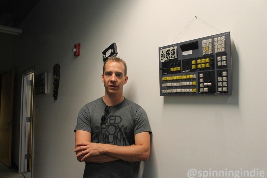 Dave Dieter in hallway at Denver Open Media. Photo: J. Waits