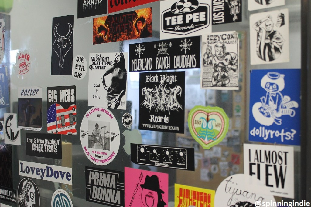 Sticker-covered window at college radio station KXLU. Photo: J. Waits