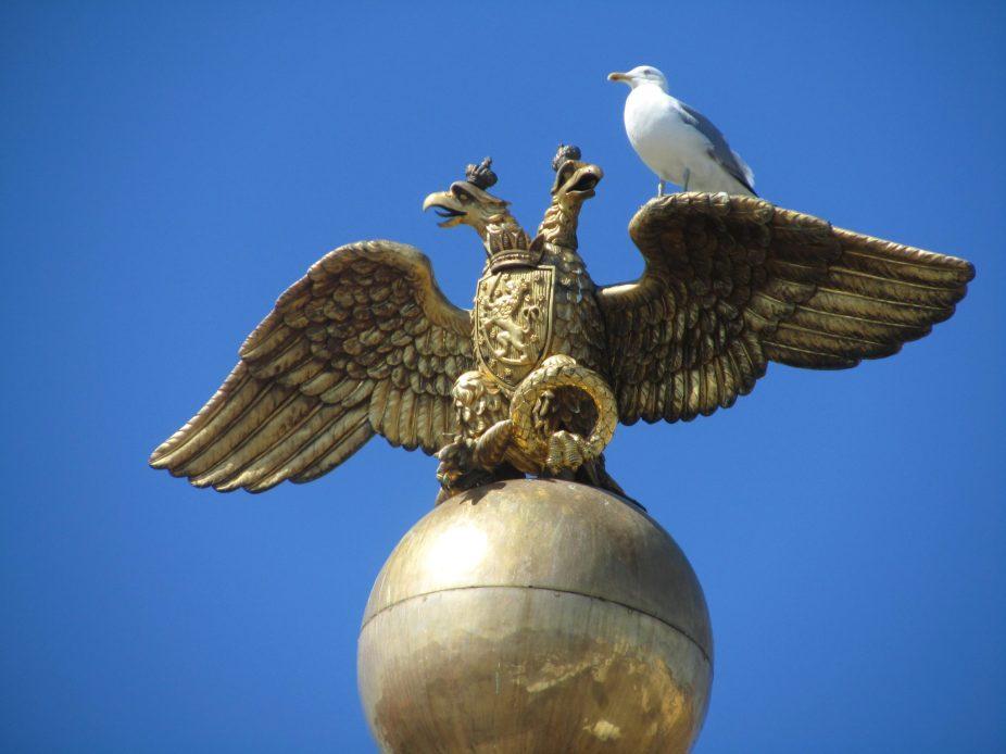 golden russian two-headed eagle sitting on an orb in Helsinki