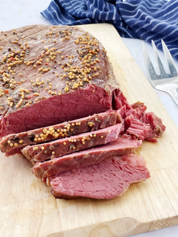 sliced corned beef roast on cutting board