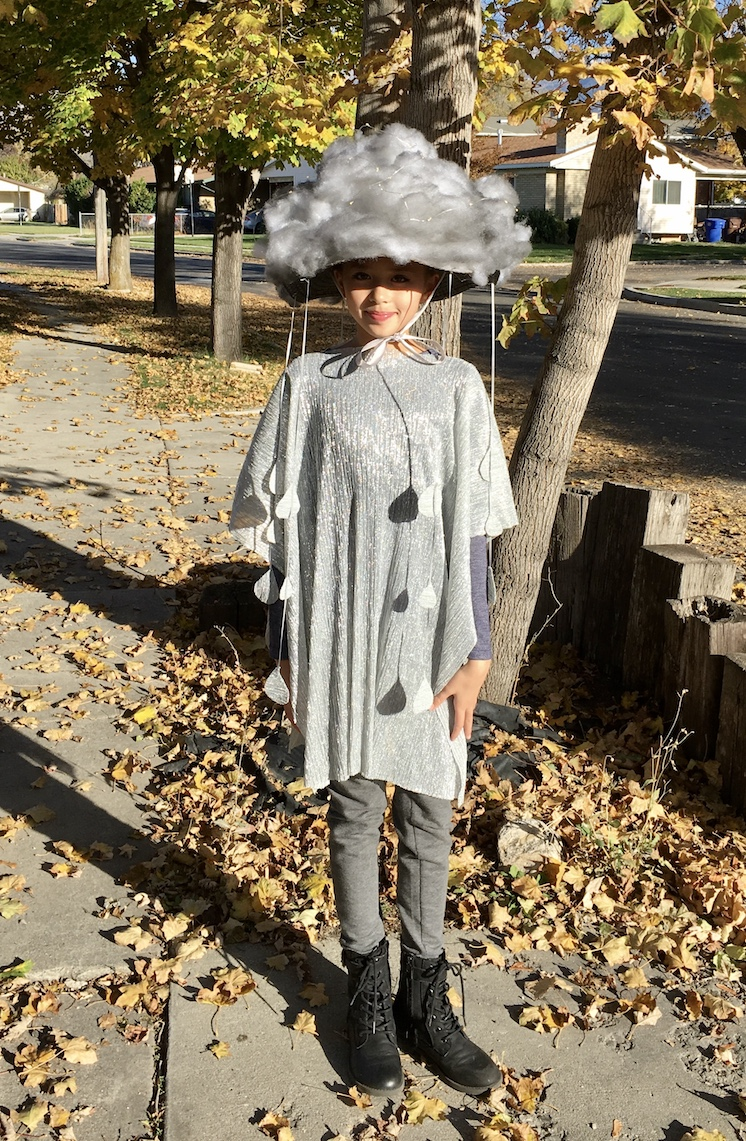girl in cloud costume with rain cloud hat