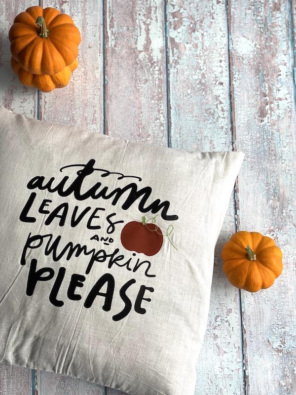 pumpkins with fall pillow