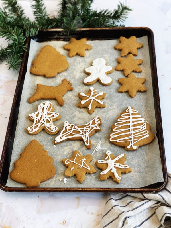 Tray of Christmas gingerbread cookies iced and uniced