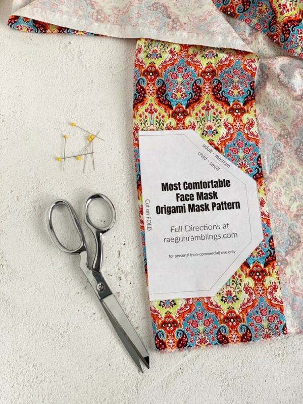 origami face mask pattern scissors and fabric