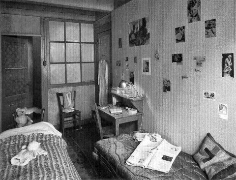 On the walls of the room in which she hid, Anne pasted pictures, one of the few things the Nazis did not strip when the Franks were arrested. The room is now refurnished to look as it might have when Anne was in hiding.