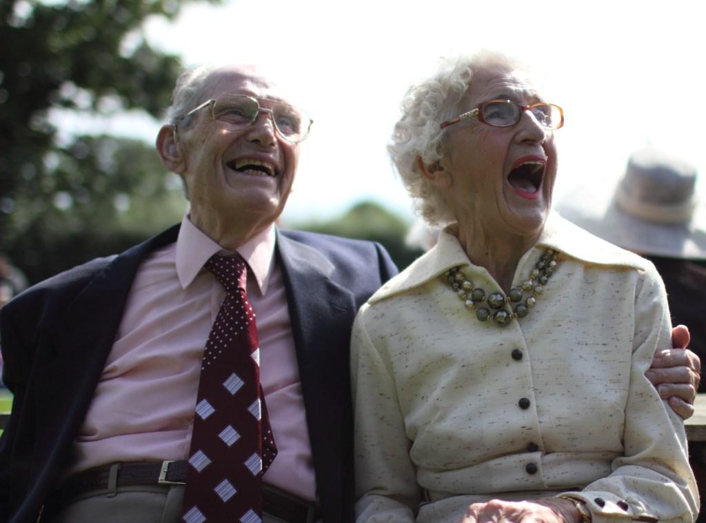 Grandma and Grandad laughing at a wedding