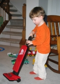 Jack with his new vacuum cleaner.