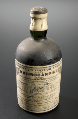 The British Medical Journal tested a bottle of this medicine in order to see what it contained. It was mainly sugar water, flavoured with a little alcohol and orange extract & 8.9% potassium bromide. Bromides were drugs commonly used in asylums of the time to calm patients, but they could cause depression and disorientation if taken regularly for long periods. It also may have contained a trace amount of Pilocarpine, a drug which has a variety of effects on the nervous system, including boosting the production of bothsaliva and sweat.