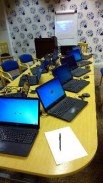12 laptop computers ready to give a class