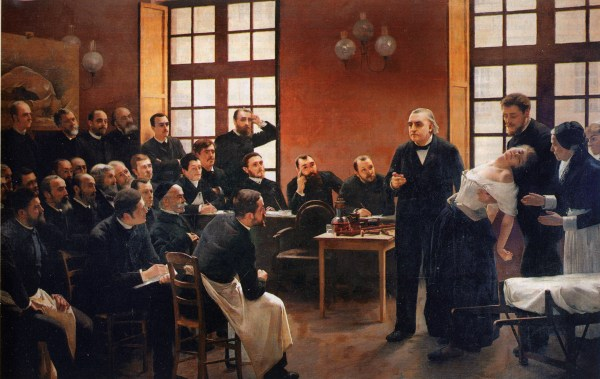 Charcot demonstrating hypnosis on a 'hysterical' Salpetriere-patient Blanche (Marie Wittmann) who is supported by Joseph Babinski