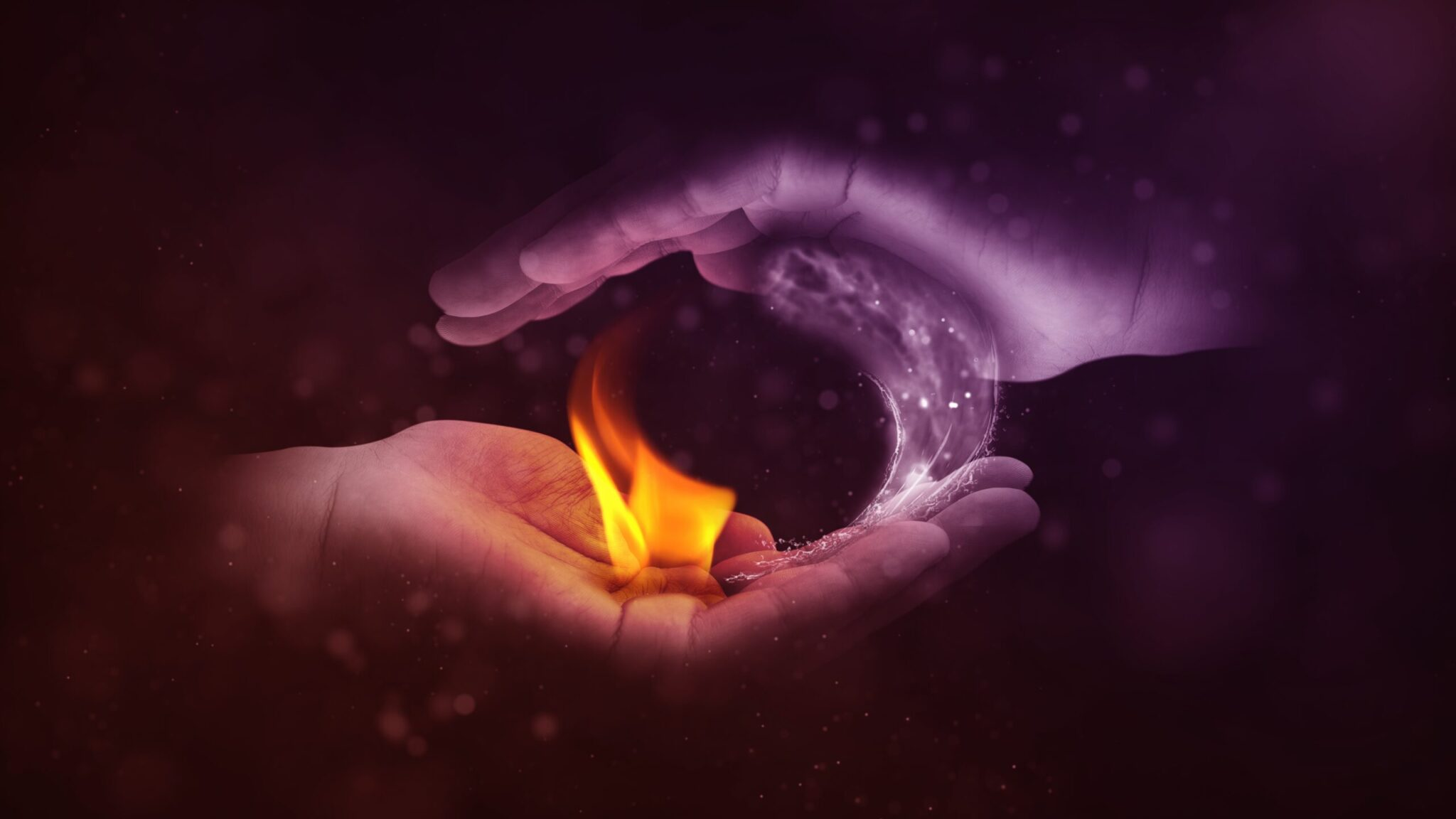 human hands cupped around a fire flame sitting in the palm of the hand next to a column of ice referencing attitude polarization