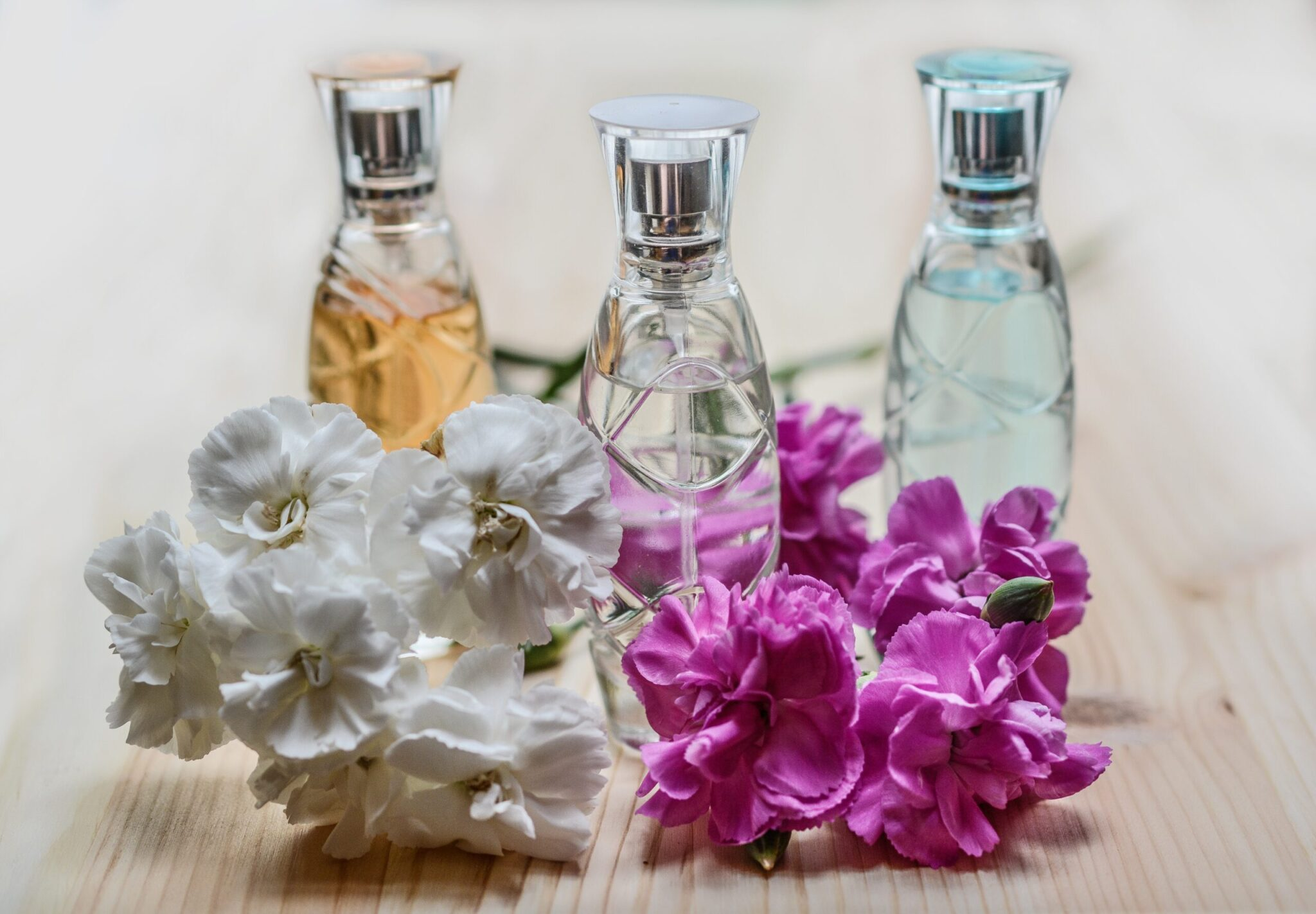 3 bottles of perfume surrounded by the fragence of several flowers to represent the 3 amazing benefits that will come with conscious living