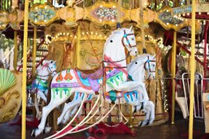 an image of carousel horses to represent the ongoing over and over again presence of the need to make decisions and choose choices